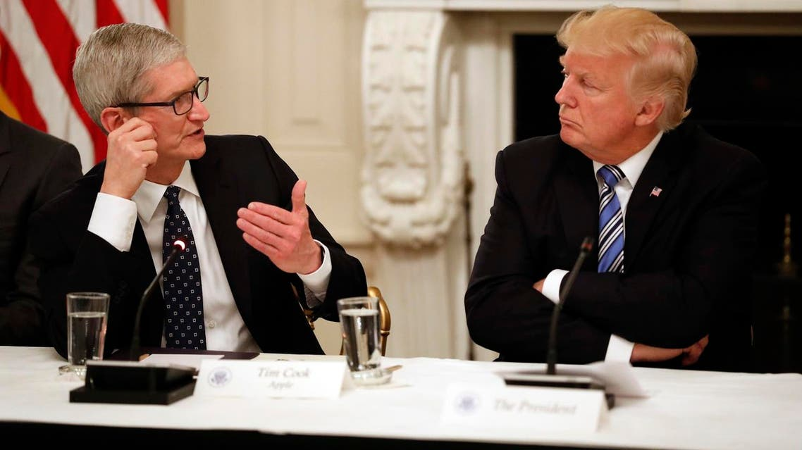 Tim Cook, CEO of Apple (left), speaks as President Donald Trump, listens during an American Technology Council roundtable in the State Dining Room of the White House, on  June 19, 2017, in Washington. (AP)