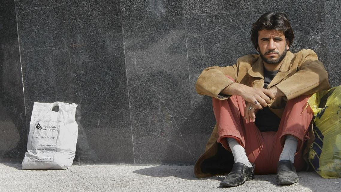 An Iranian temporary manual worker waits for work in Tehran on March 11, 2008. (AFP)