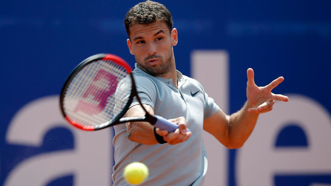 Grigor Dimitrov from Bulgaria returns the ball to Malek Jaziri of Tunisia during the Barcelona Open Tennis Tournament in Barcelona, Spain, on April 26, 2018. (AP)