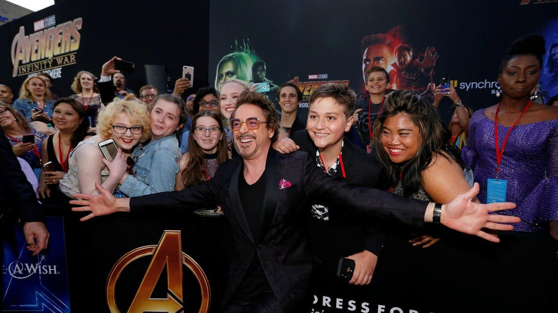 Actor Robert Downey Jr. poses with fans in Los Angeles on April 23, 2018. (Reuters)