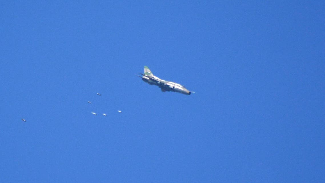 A Syrian army plane releasing bombs over the area during Syrian army shelling on April 27, 2018. (AFP)