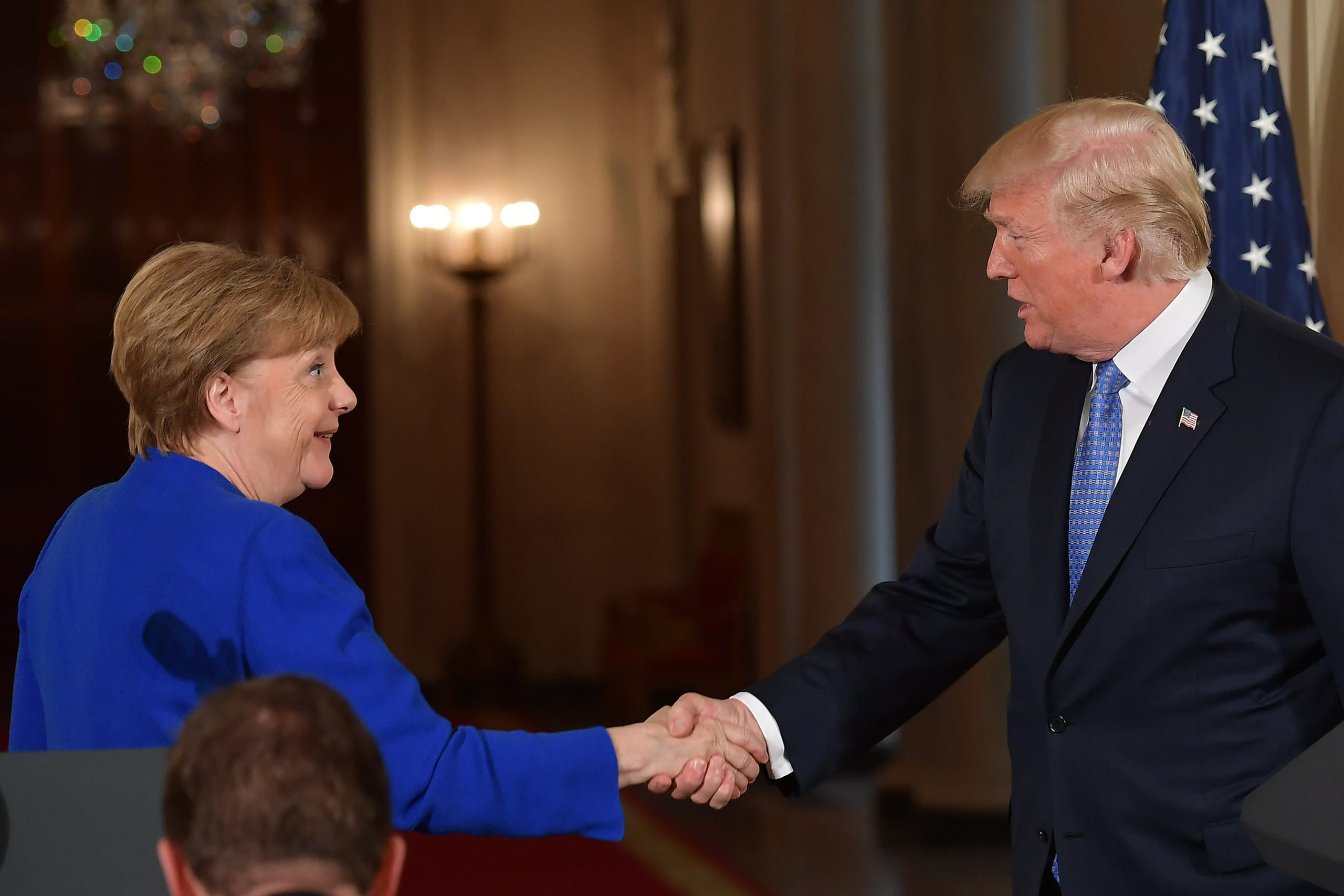 Trump and Merkel after a joint press conference at the White House on April 27, 2018. (AFP)