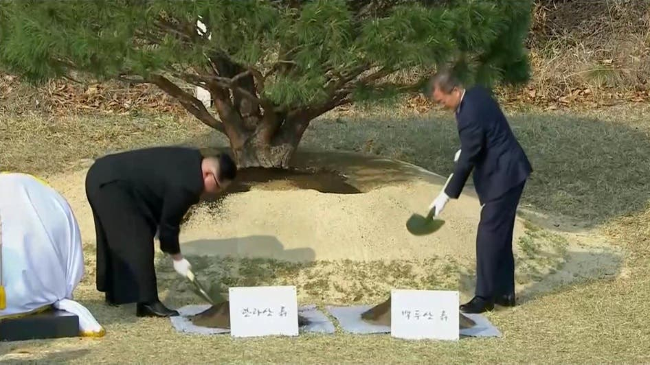 South Korean President Moon Jae-in and North Korean leader Kim Jong Un attend tree planting ceremony during the inter-Korean summit at the truce village of Panmunjom, in this still frame taken from video, South Korea April 27, 2018. Host Broadcaster via REUTERS TV