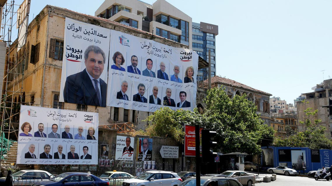 Posters with Lebanese parliament candidates are seen on a building in Beirut, Lebanon April 23, 2018. REUTERS/ Mohamed Azakir