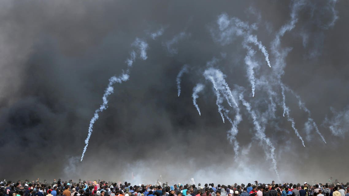 Tear gas canisters are fired by Israeli troops at Palestinian demonstrators during clashes at a protest demanding the right to return to their homeland, at the Israel-Gaza border in the southern Gaza Strip, April 27, 2018. REUTERS/Ibraheem Abu Mustafa TPX IMAGES OF THE DAY