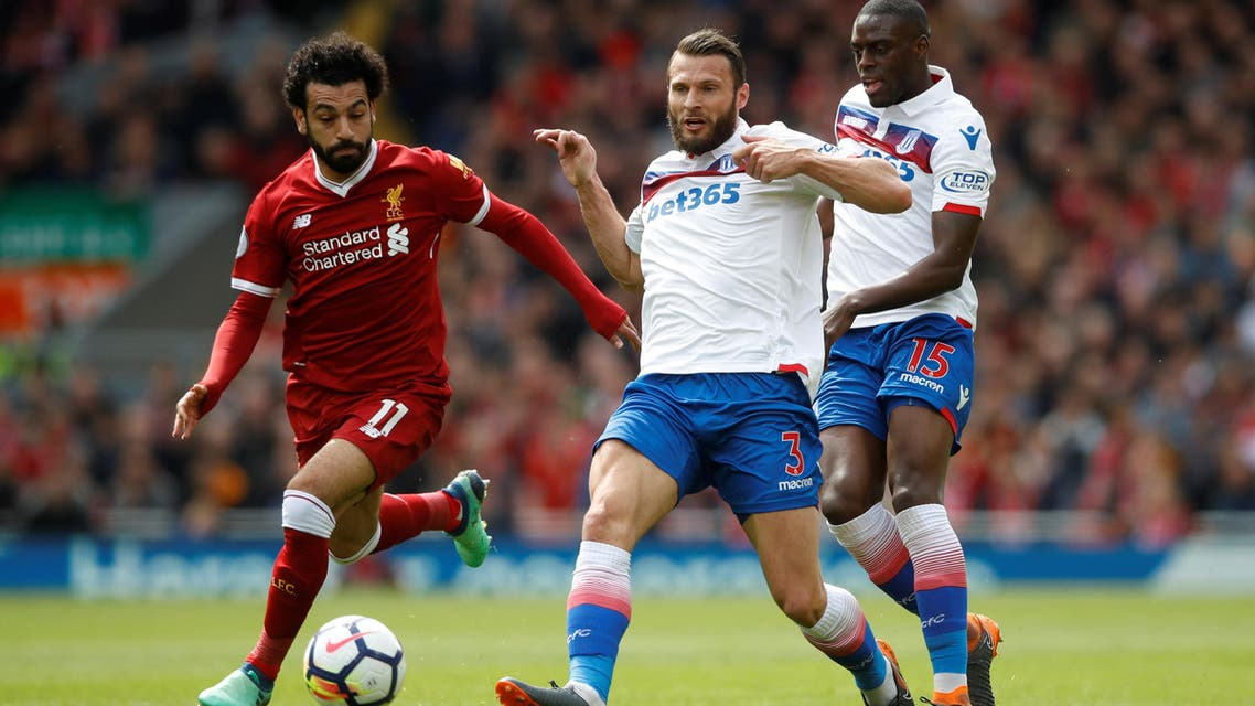 """Soccer Football - Premier League - Liverpool v Stoke City - Anfield, Liverpool, Britain - April 28, 2018 Liverpool's Mohamed Salah in action with Stoke City's Erik Pieters and Bruno Martins Indi Action Images via Reuters/Carl Recine EDITORIAL USE ONLY. No use with unauthorized audio, video, data, fixture lists, club/league logos or """"live"""" services. Online in-match use limited to 75 images, no video emulation. No use in betting, games or single club/league/player publications. Please contact your account representative for further details. (Reuters)"""
