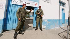 In first for Tunisia, police and soldiers head to polls