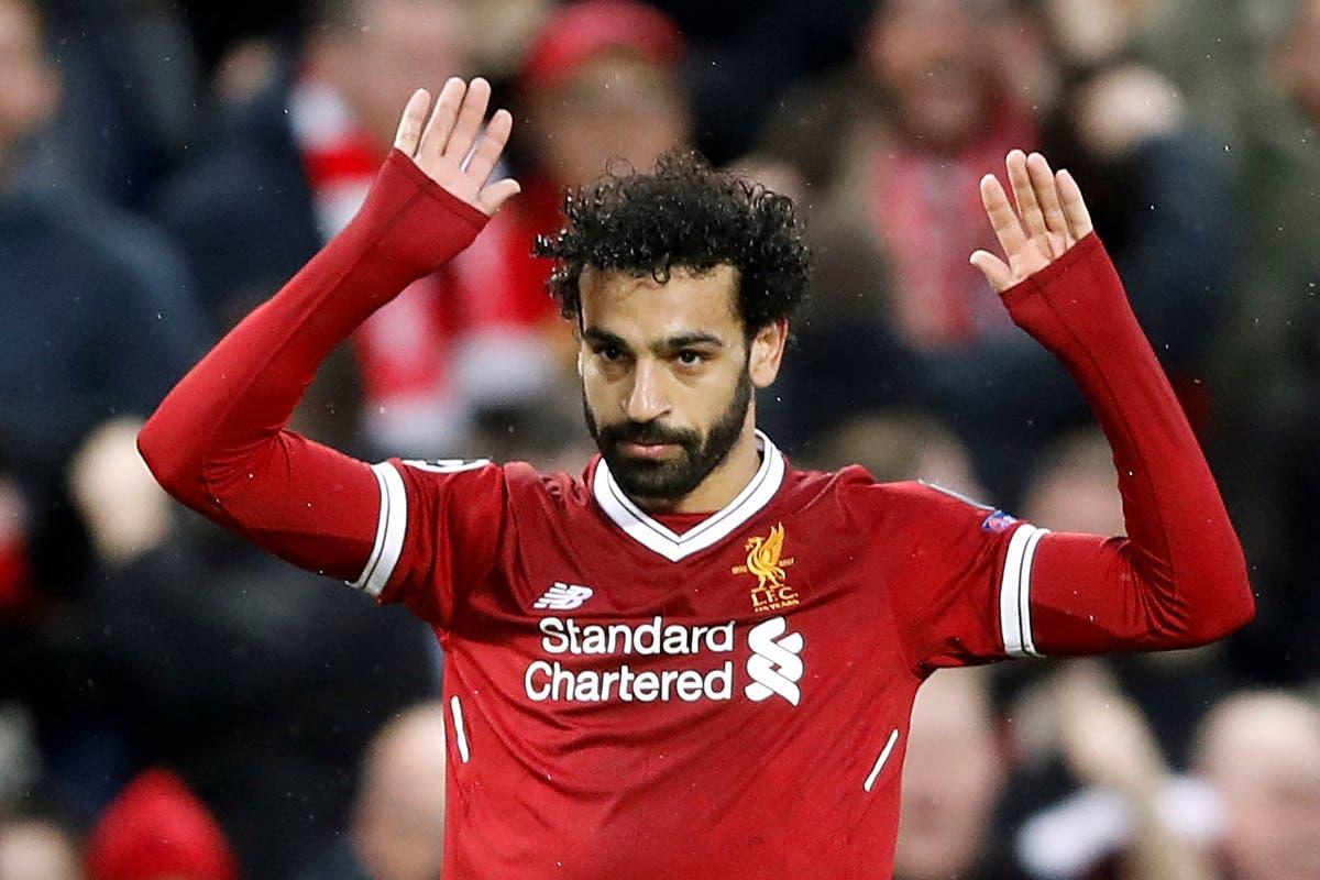 Liverpool's Mohamed Salah celebrates scoring their first goal. (Reuters)
