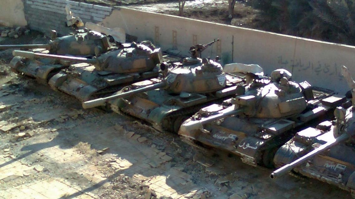 A handout picture released by Shaam News Network allegedly shows Syrian army tanks hidden inside a schoolyard before the arrival of the UN monitors to the city of Deir al-Zor. (AFP)
