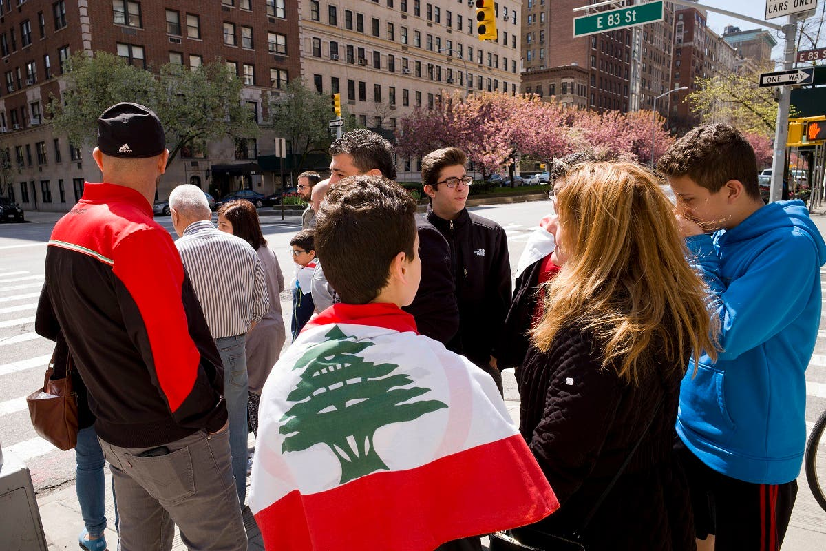 A boy wears a Lebanese flag after his parents voted, Sunday, April 29, 2018, in New York. (AP)