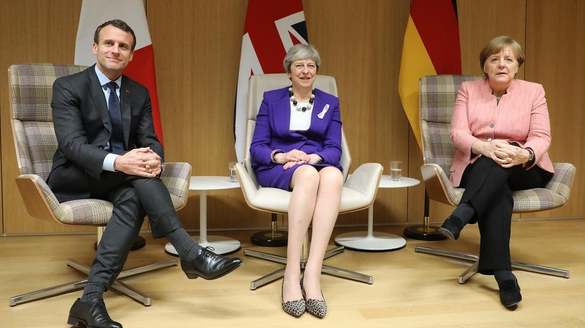 British Prime Minister Theresa May (C), German Chancellor Angela Merkel (R) and French President Emmanuel Macron (L) give a press conference following a meeting on the sidelines of the European Union leaders summit in Brussels. (AFP)