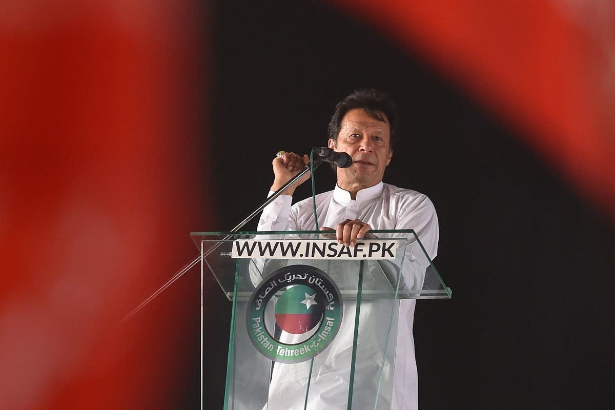 Pakistan opposition leader and leader of the Pakistani political party Pakistan Tehreek-e-Insaf (PTI - Pakistan Movement for Justice) Imran Khan delivers a speech during a political rally, in Lahore on April 29, 2018. Pakistan Tehreek-e-Insaf (PTI) displayed a strong show of power at Minar-e-Pakistan, as thousands of party supporters and workers from all over the country gathered at the ground. (AFP)