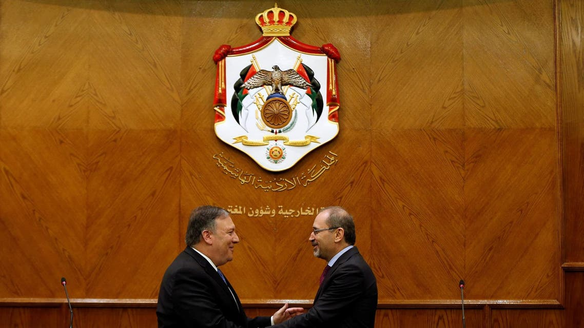 US Secretary of State Mike Pompeo shakes hands with Jordanian Foreign Minister Ayman Safadi following a joint news conference with in Amman, Jordan, April 30, 2018. (Reuters)