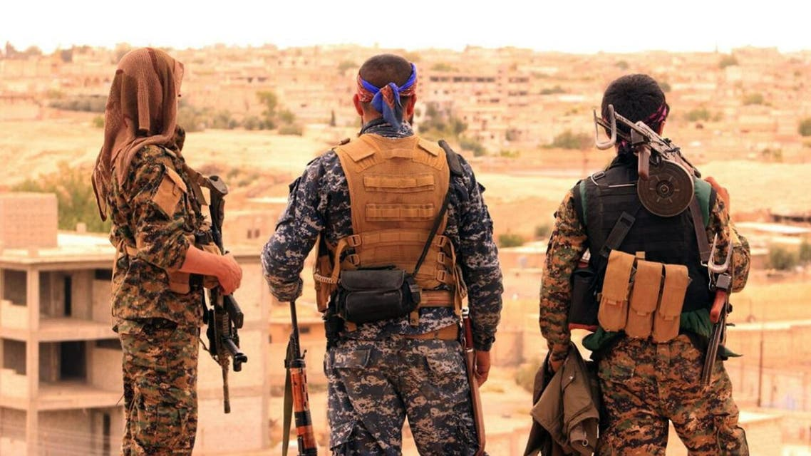 Fighters from the SDF looking toward the northern town of Tabqa, Syria. (File photo: AP)