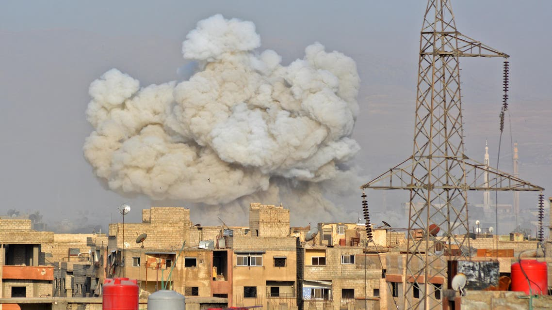 A general view shows smoke rising from buildings during regime strikes on the Palestinian camp of Yarmuk and the neighbouring al-Hajar al-Aswad district, in southern Damascus, on May 1, 2018. A deal has been reached for the evacuation of the Palestinian refugee camp of Yarmuk where Islamic State group fighters have been holed up in southern Damascus, state media reported. Rami al SAYED / AFP