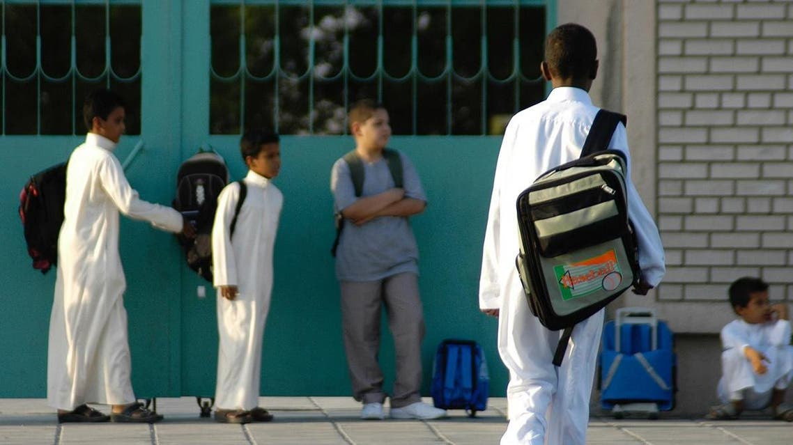 Saudi schoolboys wait for the bus in front of their school as Saudi schools start the first day in the eastern city of Dammam. (File photo: AFP)
