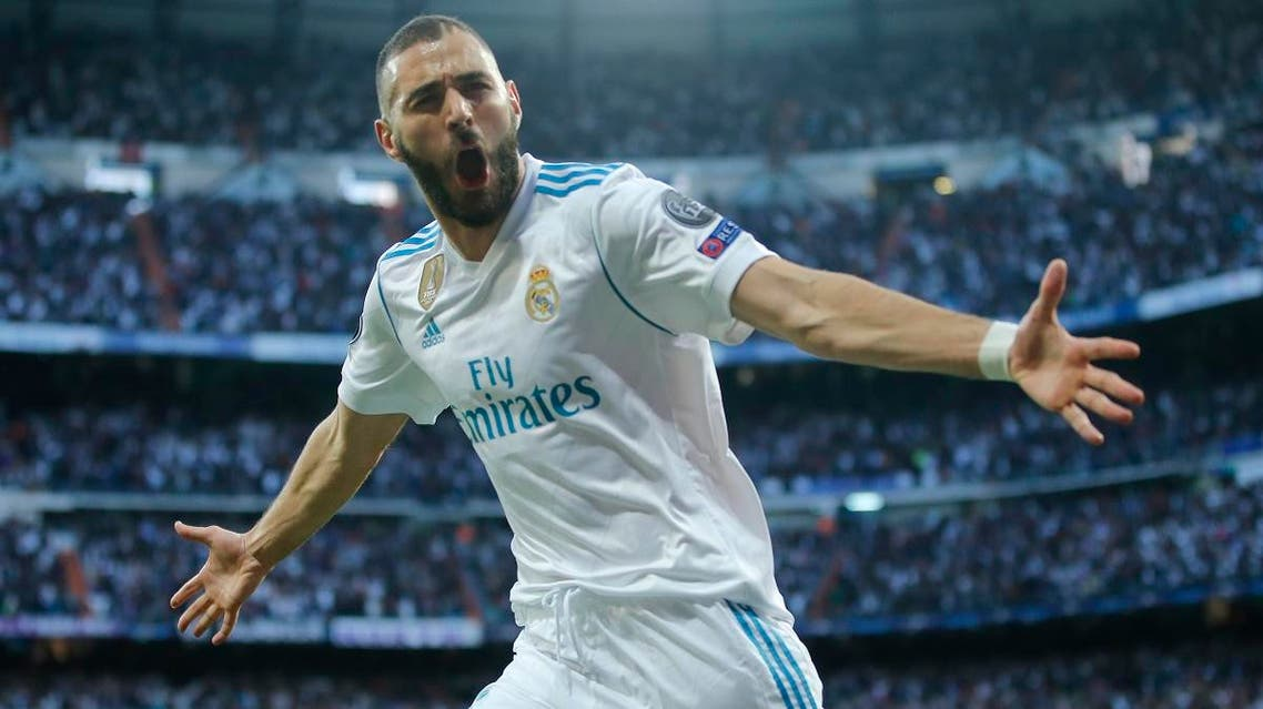 Real Madrid's Karim Benzema celebrates after scoring his side's opening goal during the Champions League semifinal second leg. (AP)