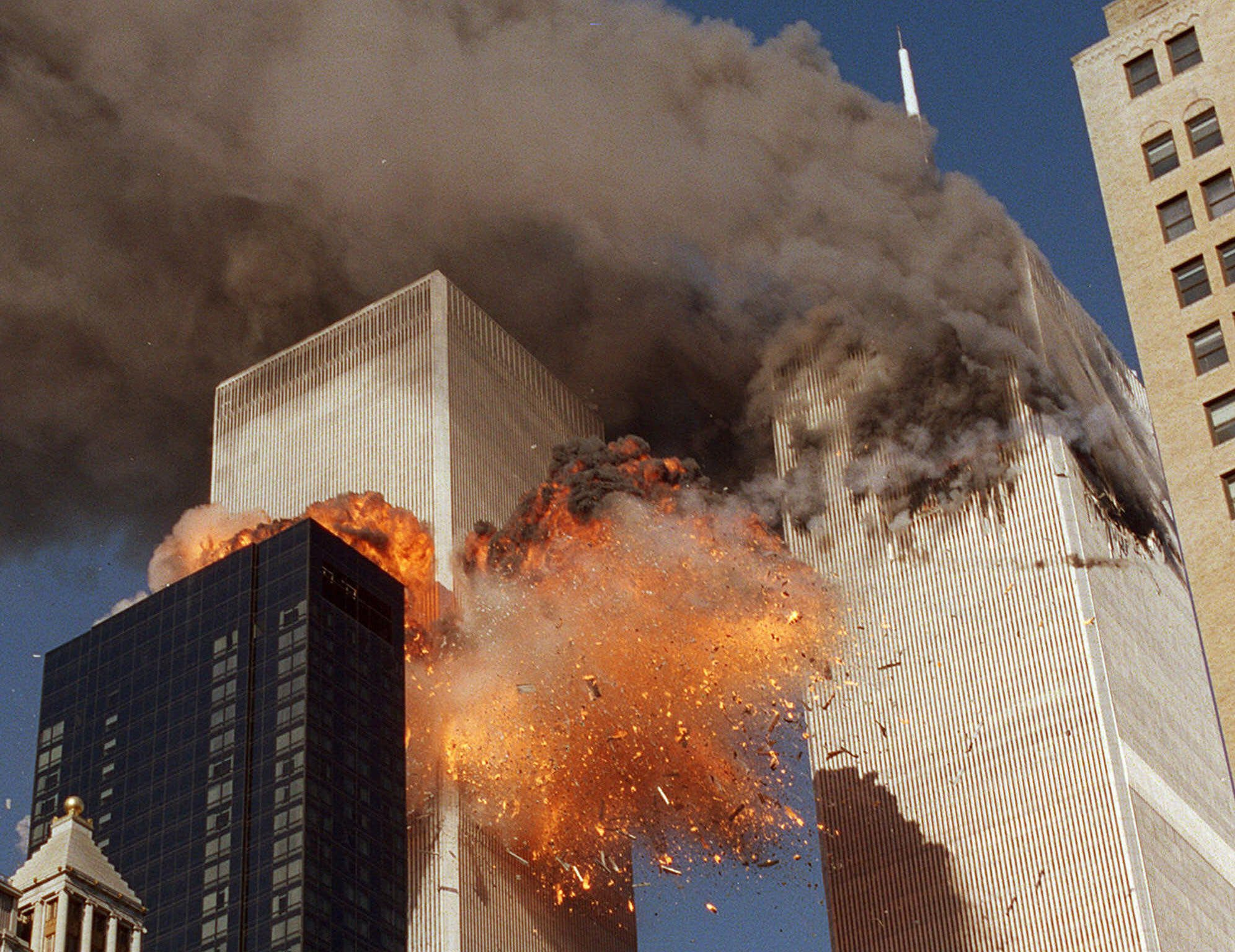 smoke billows from one of the towers of the World Trade Center and flames. (AP)