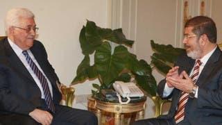 لقاء سابق بين الرئيس المخلوع محمد مرسي والريس محمود عباس