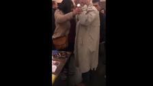 WATCH: Iranian academic beats up female activist at Brussels event