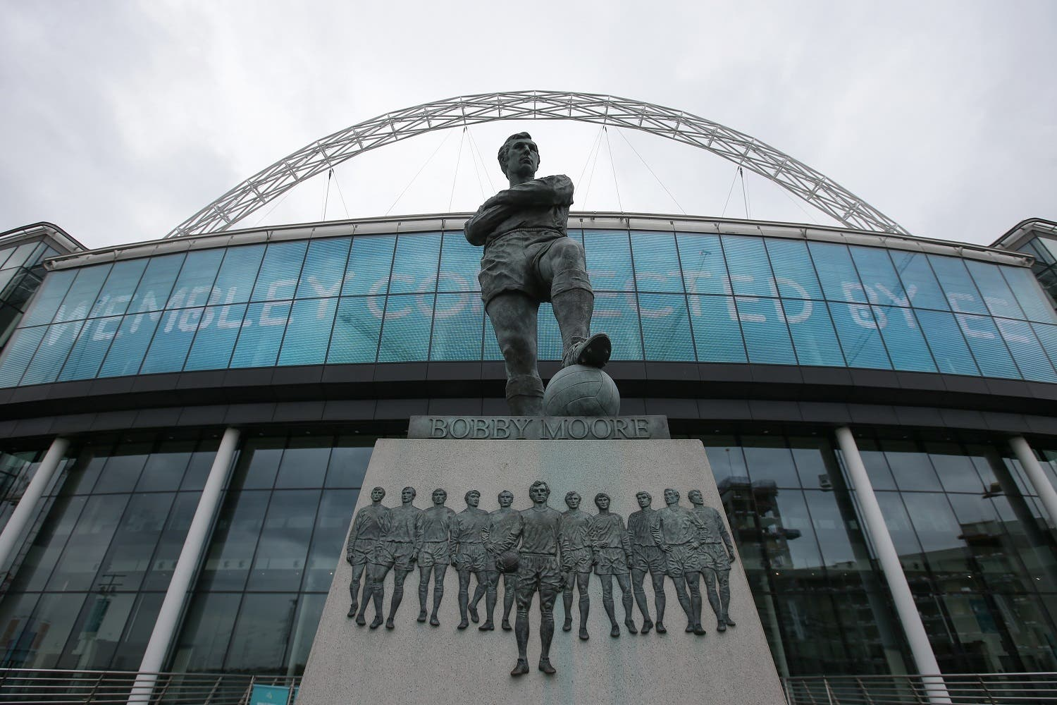 A statue of former England football captain Bobby Moore stands outside Wembley Stadium in west London, on April 27, 2018. The Football Association have received an offer to buy iconic Wembley stadium in a shock move that increases the chances of an NFL team taking up permanent residence in London. (AFP)