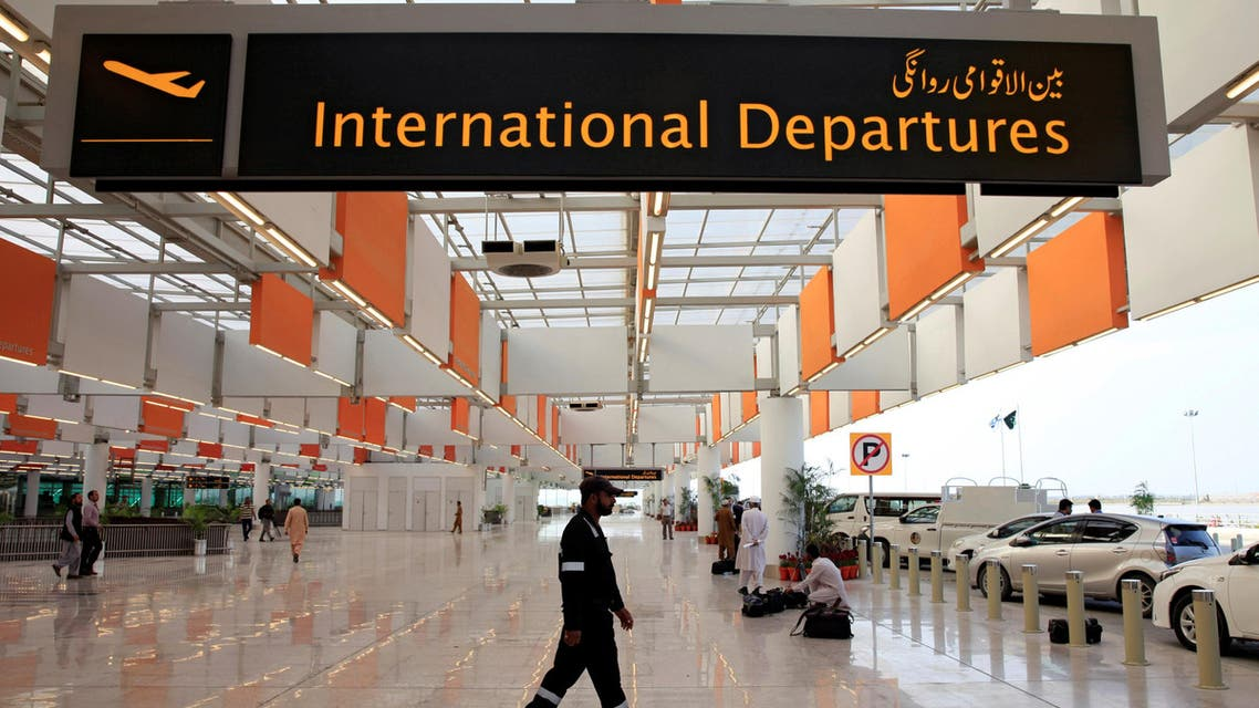 A worker walks at the departure area of the newly built Islamabad International Airport. (Reuters)
