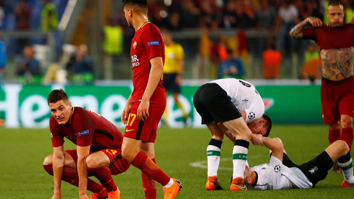 Roma's Patrik Schick and Cengiz Under look dejected as Liverpool players celebrate after the match. (Reuters)