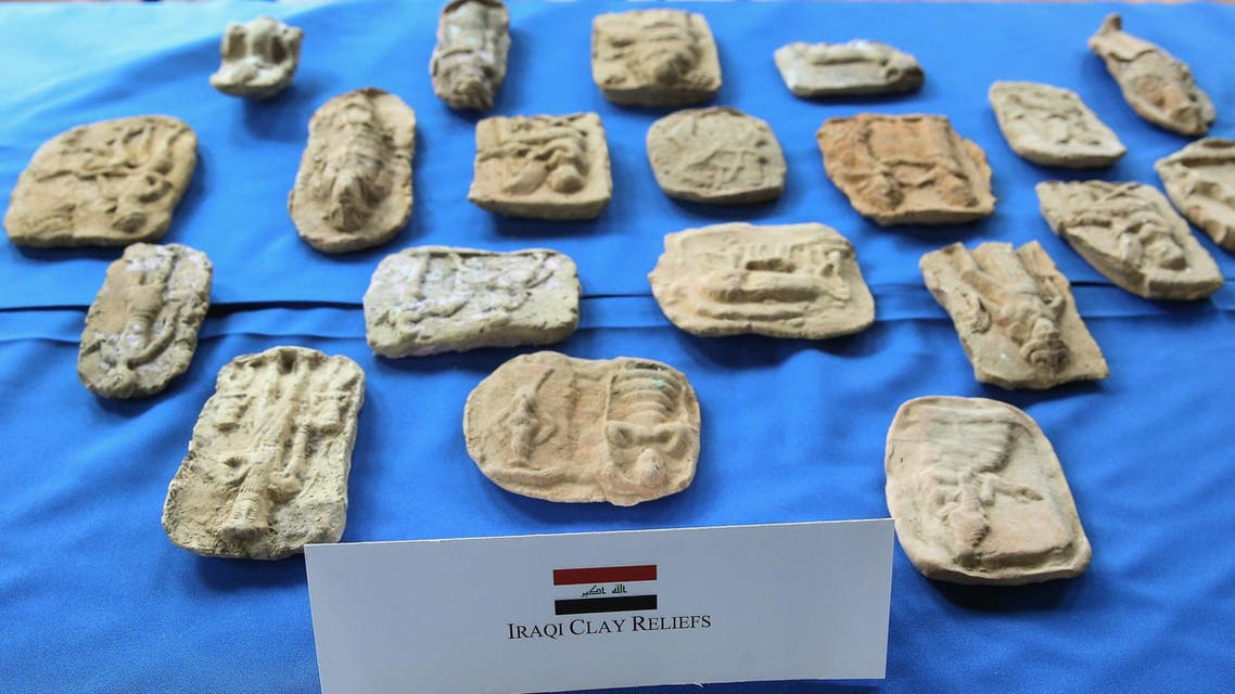 Ancient Iraqi clay reliefs on display during a ceremony to repatriate Iraqi cultural items smuggled into the US, March 16, 2015, in Washington, DC. (AFP)