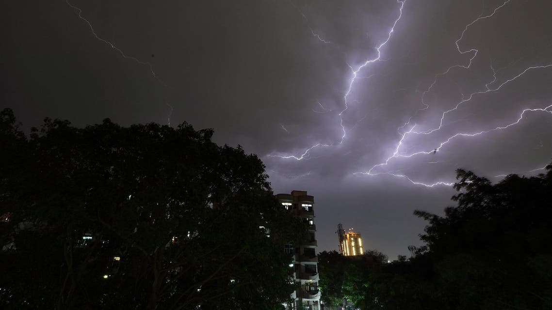 Lightning strikes over residential apartments during a thunderstorm on the outskirts of New Delhi on May 2, 2018. (AFP)