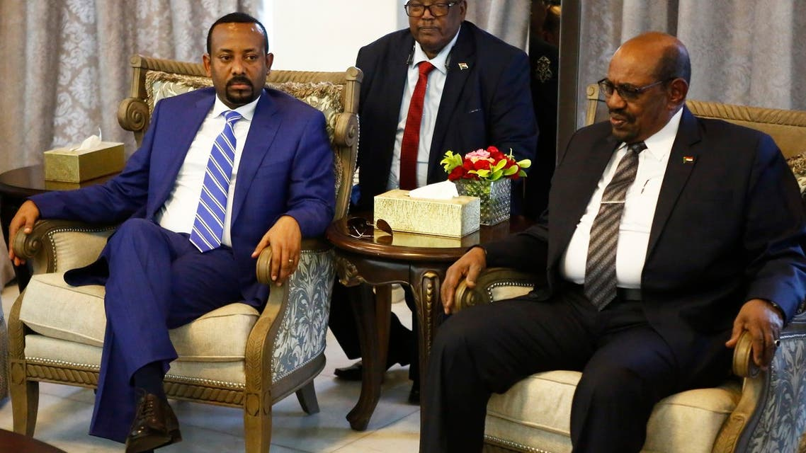 Ethiopian Prime Minister Abiy Ahmed (L) meets with Sudanese President Omar al-Bashir (R) following his arrival in Khartoum for an official visit to Sudan on May 2, 2018.