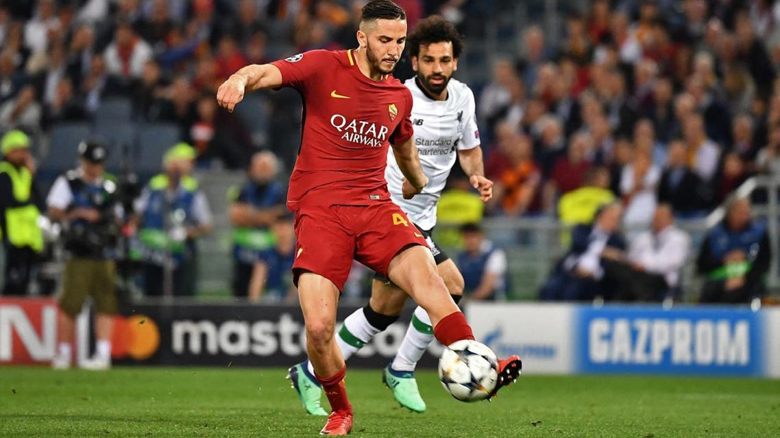 Roma defender Kostas Manolas (L) vies Liverpool's midfielder Mohamed Salah during the UEFA Champions League semi-final second leg football match at the Stadio Olimpico in Rome on May 2, 2018. (AFP)