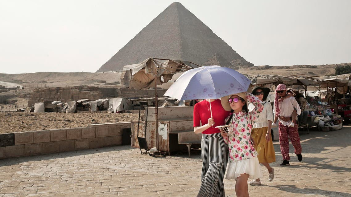 Asian tourists leave after visiting the Giza Pyramids in Egypt on Aug. 7, 2017. (AP)