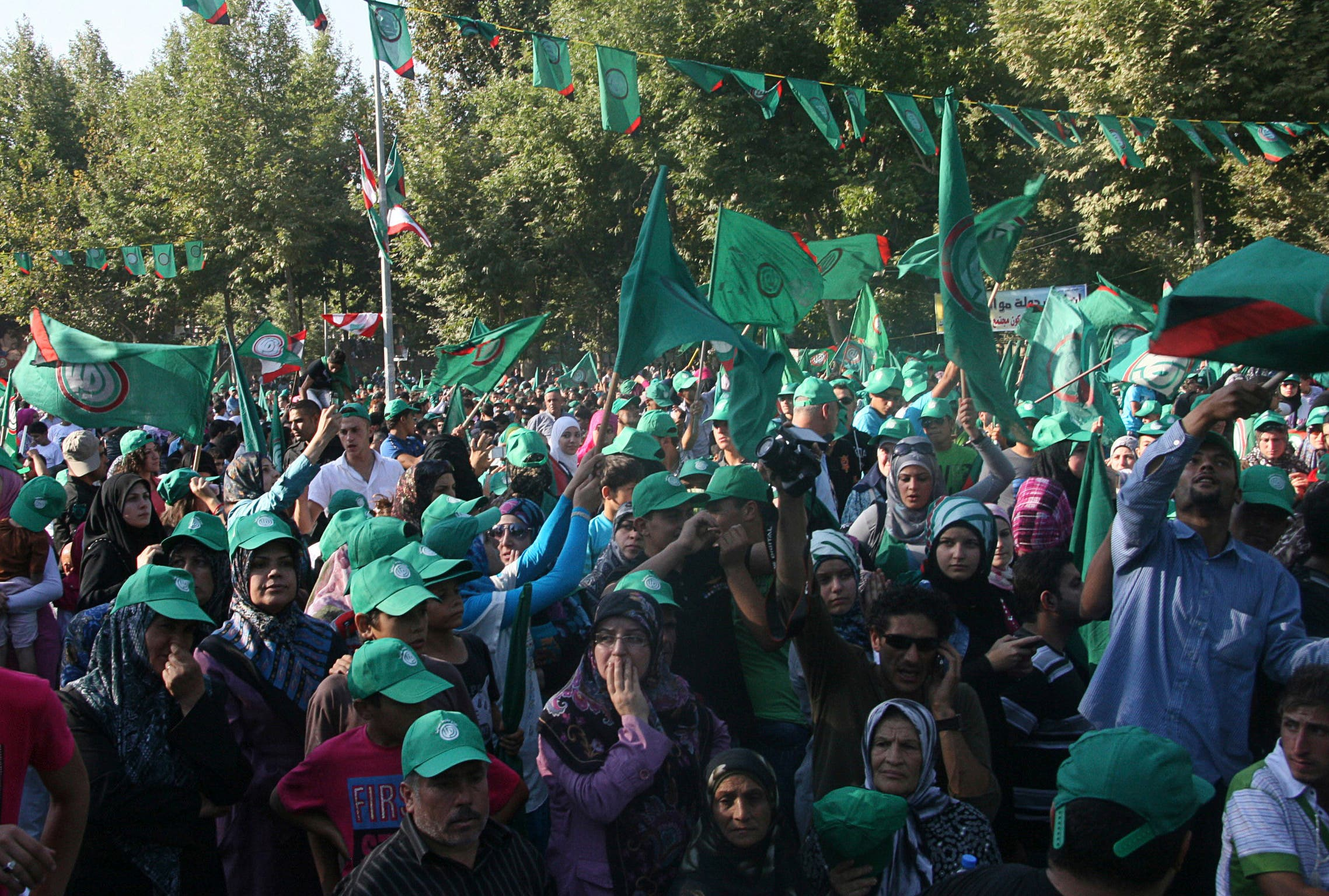 Supporters of the Shi'ite Amal movement wave flags during a rally to mark the 33rd anniversary of the disappearance of Imam Musa al-Sadr, who was the founder and leader of the Amal movement in Lebanon, in Baalbeck, in the Bekaa valley August 31, 2011. Sadr, the founder of the Shi'ite Amal movement, disappeared with his two companions on a visit to Libya in 1978. REUTERS/ Ahmad Shalha (LEBANON - Tags: POLITICS CIVIL UNREST)