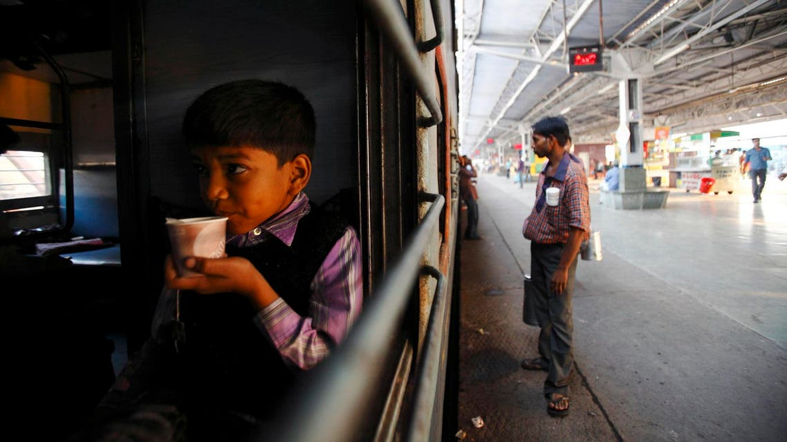 A boy drinks tea inside a train at Agra Cantt Railway Station on October 24, 2012. (File photo: Reuters)