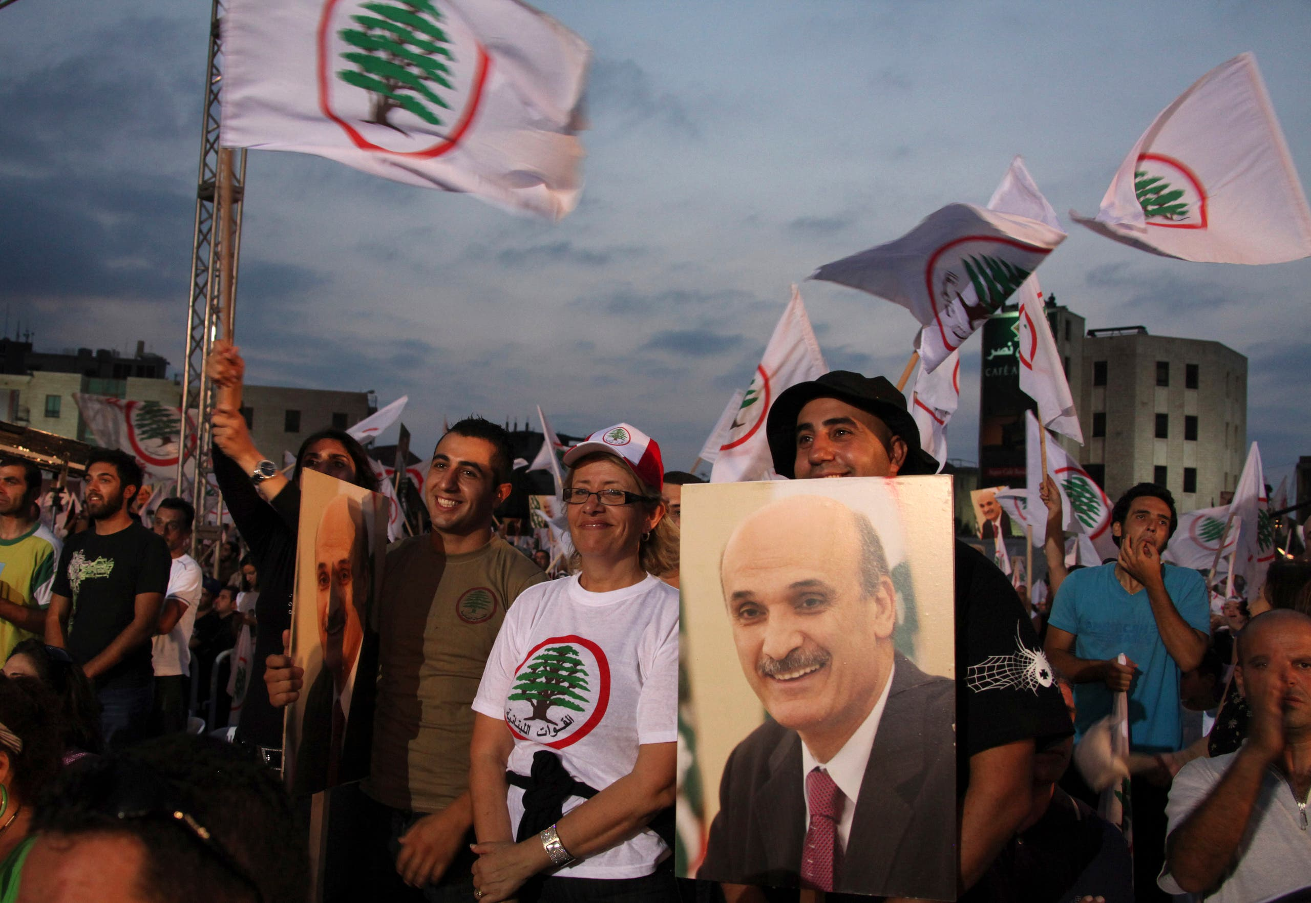 Supporters of Lebanon's leader of the Christian Lebanese Forces Samir Geagea, carry his picture and wave flags during a rally held for the commemoration of the LF's Lebanese Resistance Martyrs in Jouniyeh, north of Beirut, September 25, 2010. (Reuters)