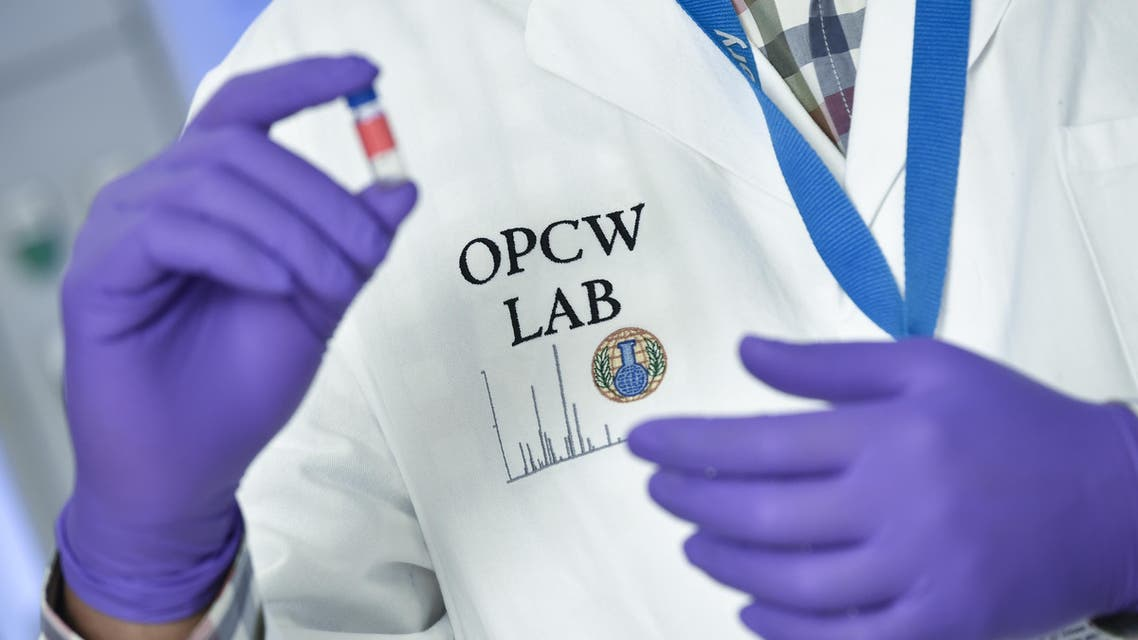 A laboratory technician controls a test vial at the OPCW (The Organisation for the Prohibition of Chemical Weapons) headquarters in the Hague, The Netherlands, on April 20, 2017. Tucked away in a small industrial zone in the Dutch suburb of Rijswijk, the two-storey building, with about 20 staff, has been key to the two decades of painstaking work by the Organisation for the Prohibition of Chemical Weapons (OPCW) to eliminate the world's toxic arms stockpiles. (AFP)