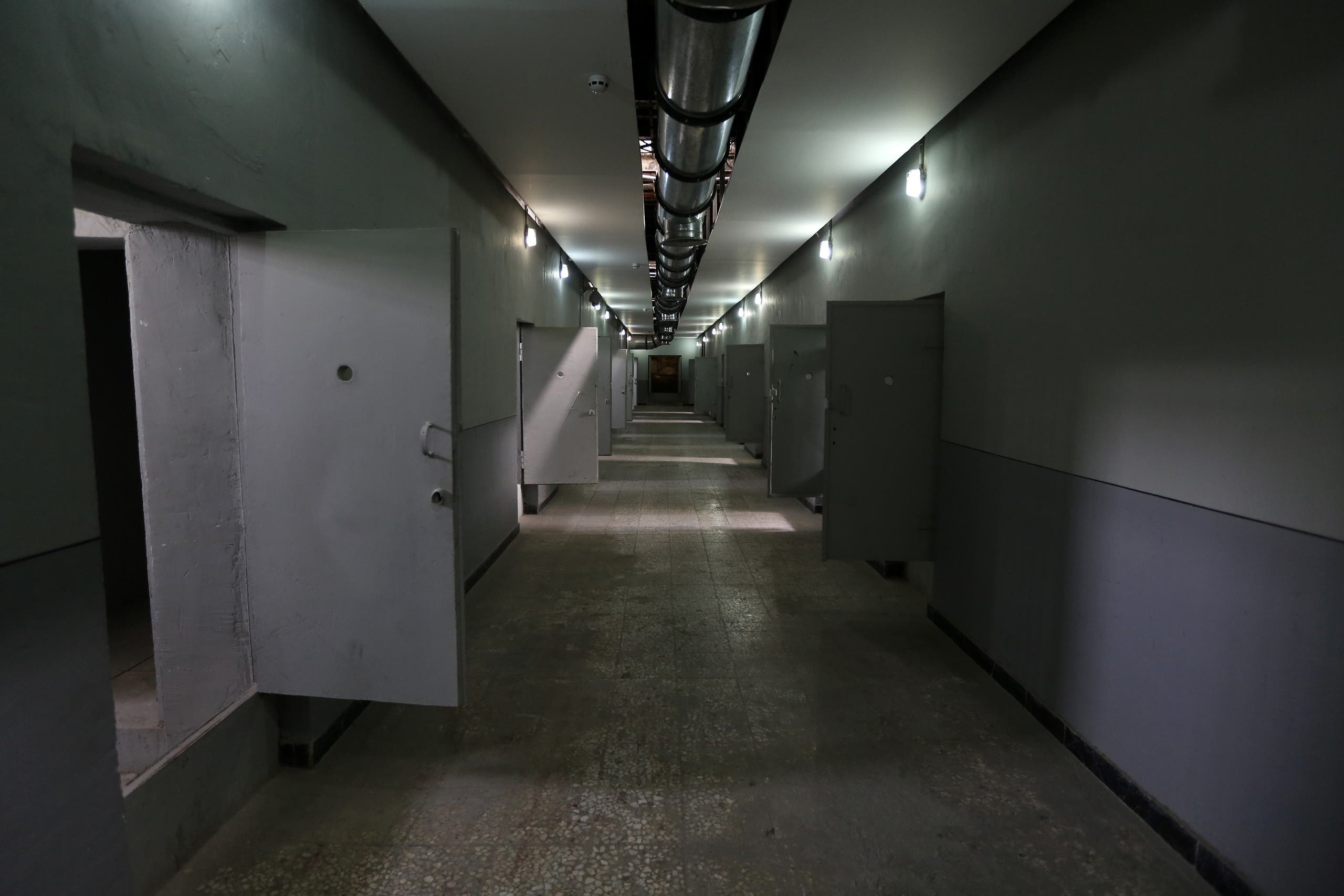 """A picture taken on September 2, 2014 in Tehran shows portraits of detainees in """"Qasr prison"""", a former prison hosting political prisoners that was turned into a museum in 2012. (AFP)"""