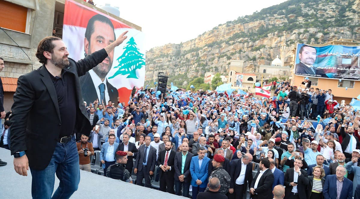 Lebanon's Prime Minister Saad al Hariri waves during an election campaign in the northern town of Deniyeh. (Reuters)