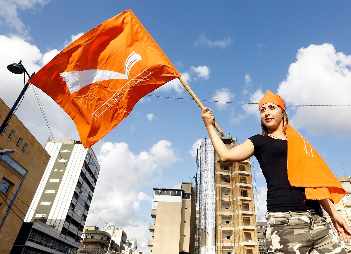 A Lebanese woman holds a Free Patriotic Movement party flag as supporters take to the streets in Jdeideh, on the northern outskirts of the capital Beirut. (AFP)