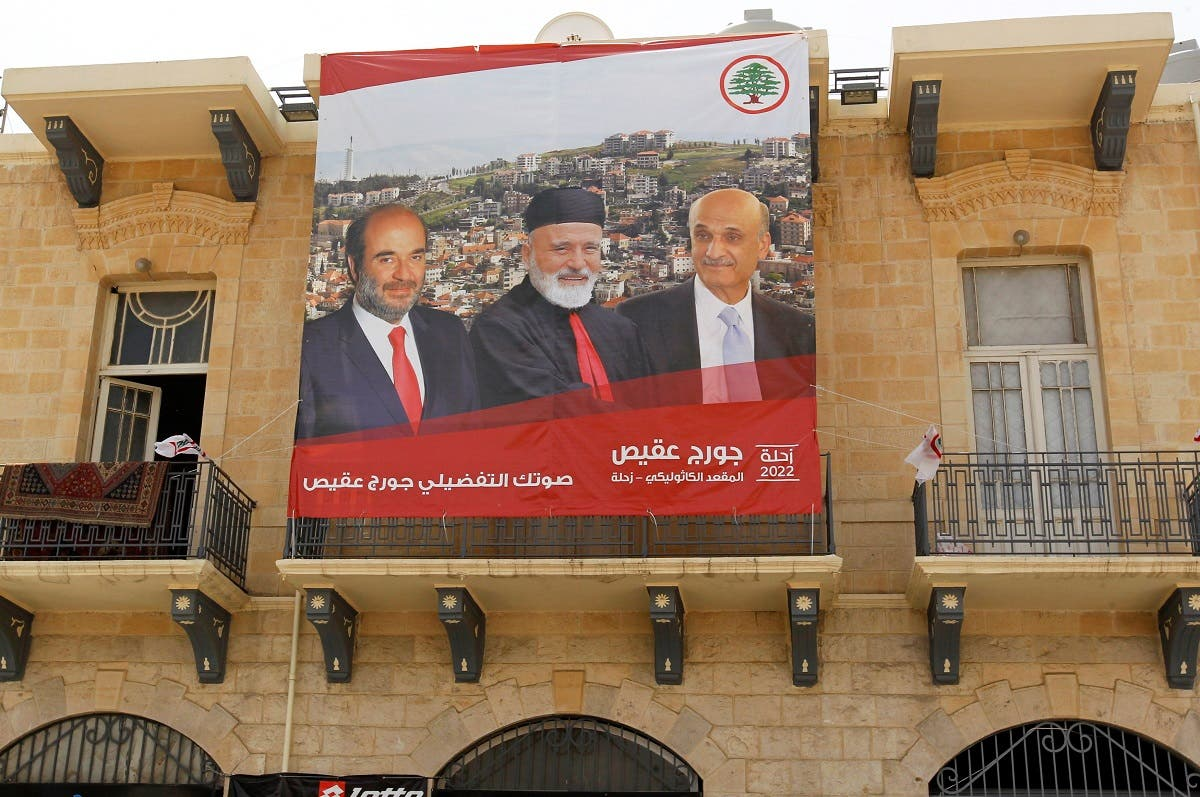 A poster of Samir Geagea, leader of the Christian Lebanese Forces, former Lebanon's Christian Maronite Patriarch Mar-Nasrallah Boutros Sfeir and Lebanese parliament candidate Georges Aqeis hangs on a building in the city of Zahle. (Reuters)