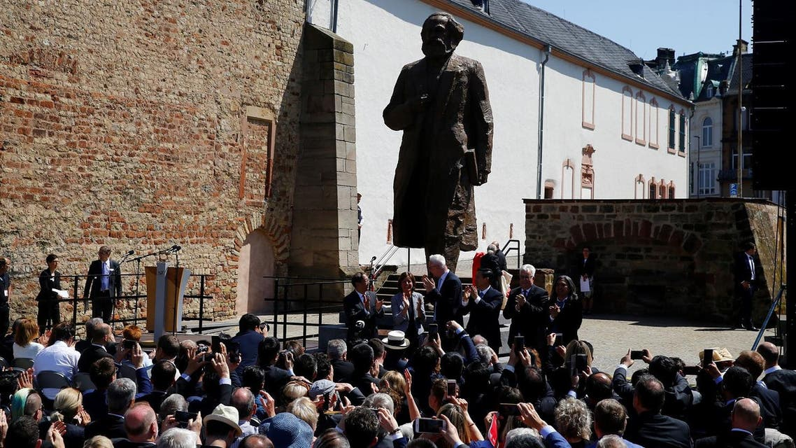The bronze statue of Karl Marx, created by Chinese artist Wu Weishan and donated by China to mark the 200th birth anniversary of the German philosopher, is seen in his hometown Trier, on May 5, 2018. (Reuters)