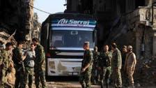 خروج مقاتلي حمص وحماة يتوالى.. وتسليم للسلاح الثقيل