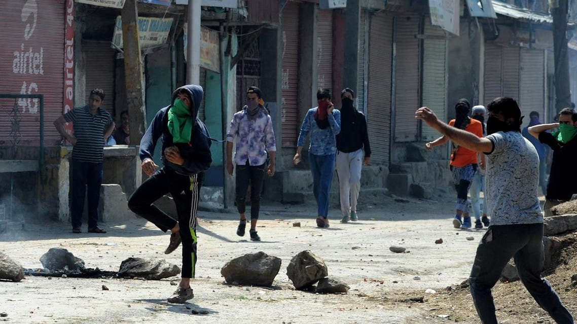 Indian security personnel and protesters clash following a gunbattle between security forces and suspected rebels in Srinagar. (AFP)