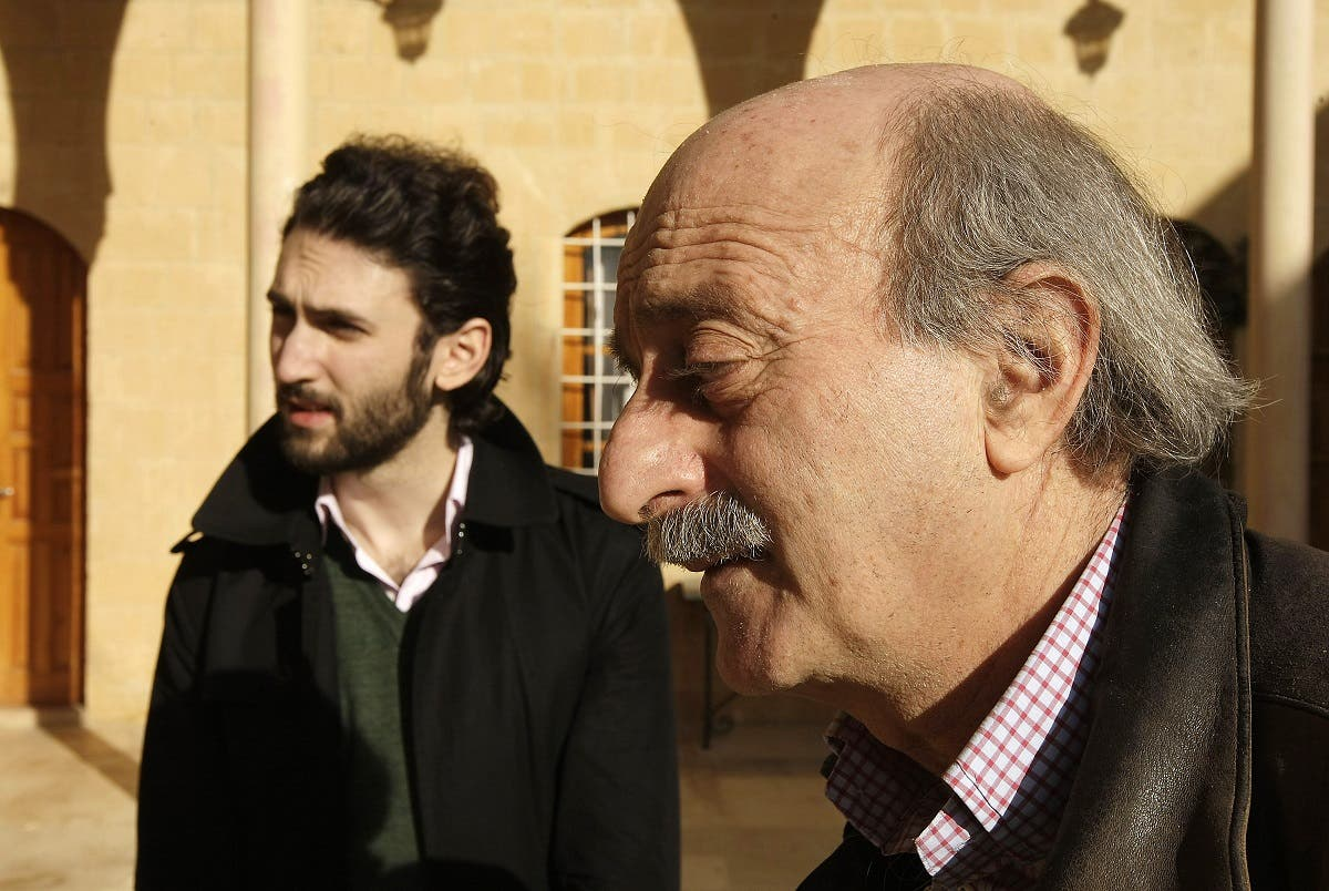 Lebanese Druze leader Walid Jumblatt walks with his eldest son Taymur (L) at their ancestral home in Mukhtara in Lebanon's Shouf mountains, southeast of Beirut, on Januray 16, 2010. (AFP)