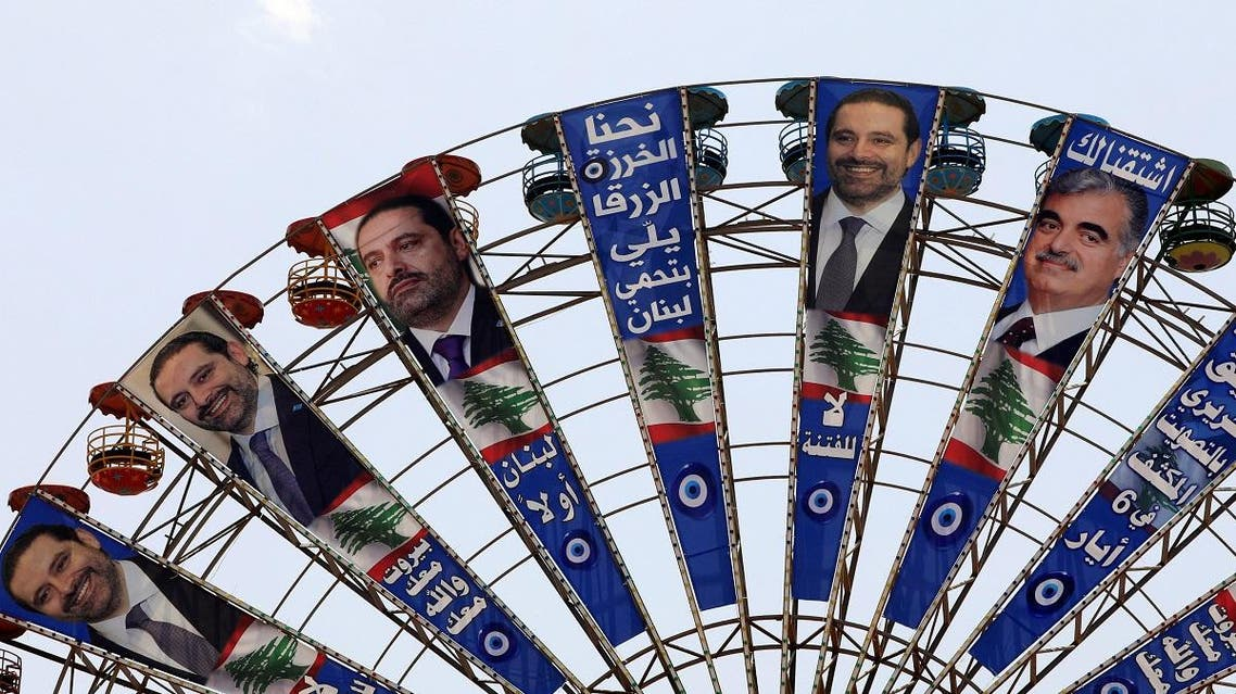 Campaign posters of Lebanese PM and candidate for parliamentary election Saad al-Hariri and his father hang on Ferris Wheel in Beirut. (Reuters)