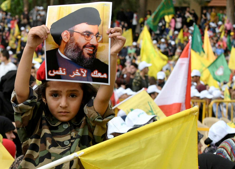 A child holds a picture of Hezbollah leader Hassan Nasrallah during election rallies a few days before the general election in Baalbeck. (File Photo: Reuters)