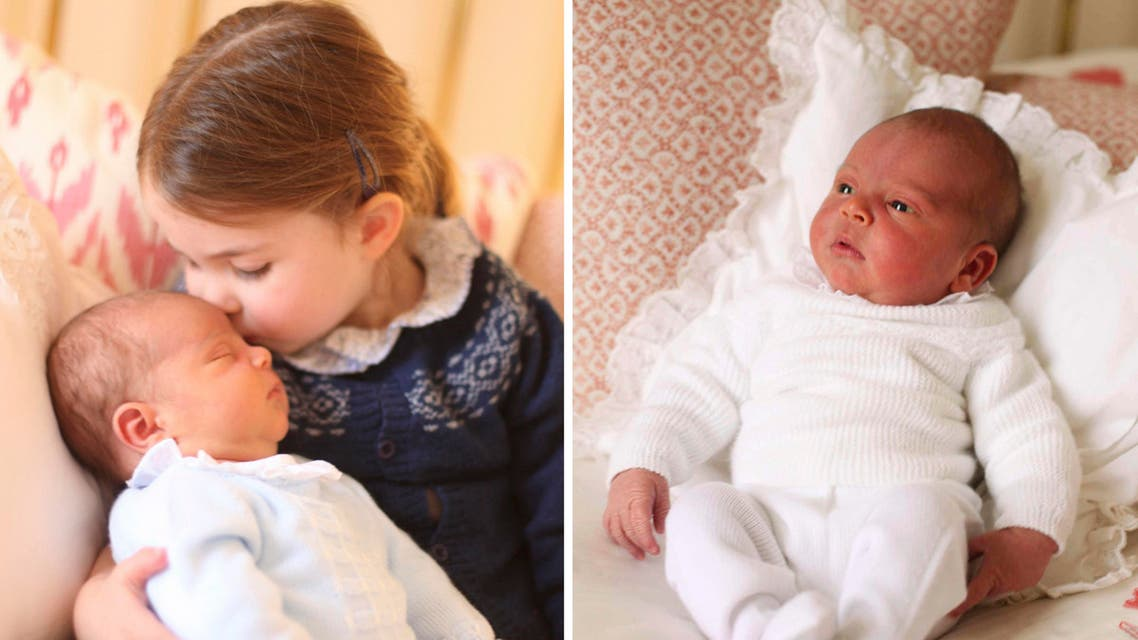 In this May 2, 2018 photograph provided by Kensington Palace, Britain's Princess Charlotte cuddles her brother Prince Louis, on her third birthday, at Kensington Palace, in London. (AP)