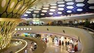 مطار أبوظبي يلزم القادمين بالحجر.. وارتداء سوار طبي
