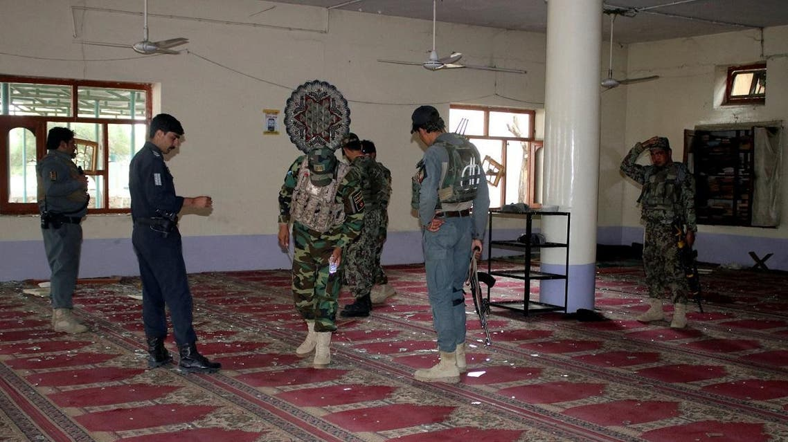 Afghan policemen inspect a mosque after a blast in Khost province. (Reuters)