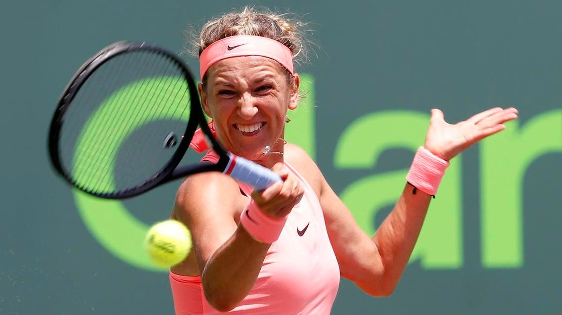 Victoria Azarenka, of Belarus, returns a shot to Sloane Stephens during their semifinal match in the Miami Open. (AP)